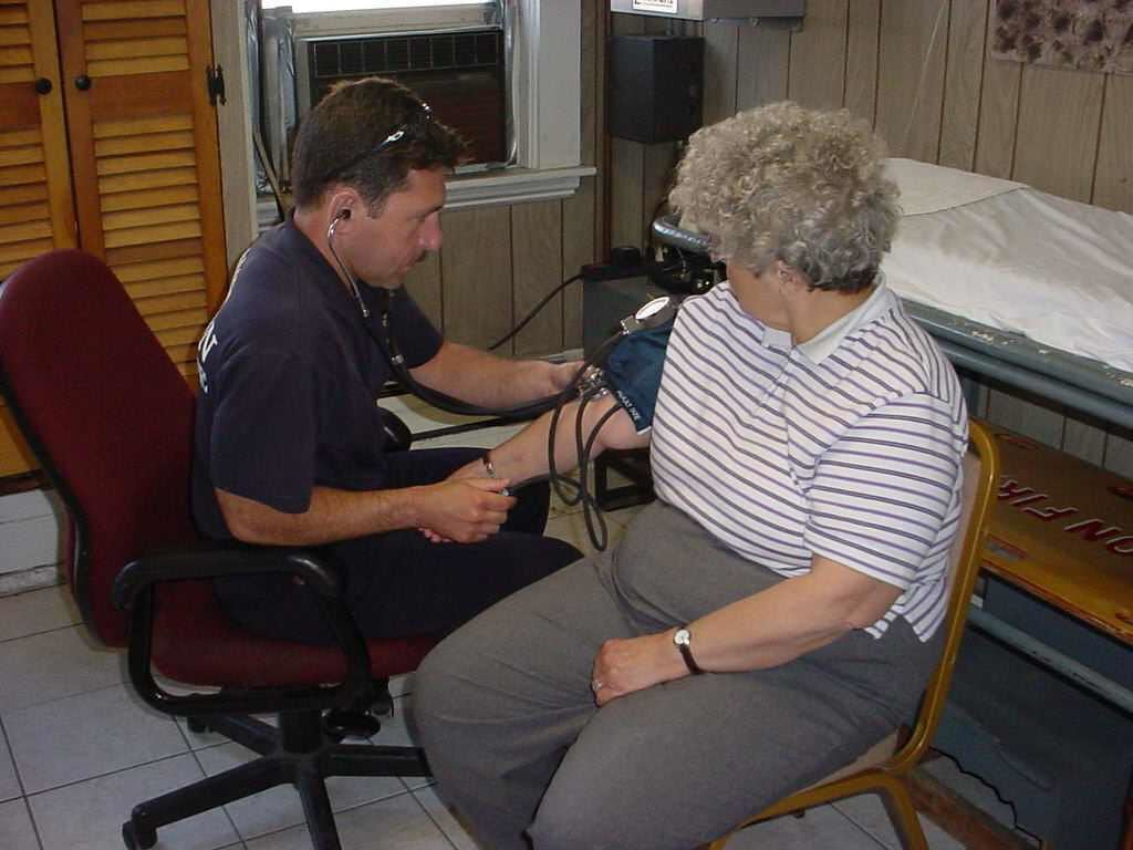 Elderly Woman Having Her Blood Pressure Checked